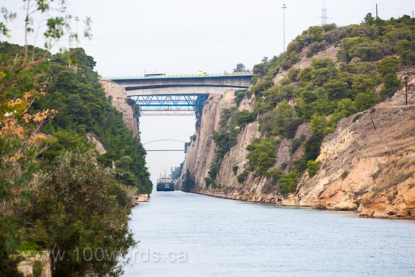 A ship travels through the Corinth Canal.